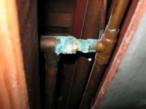 Corroded copper bathroom plumbing