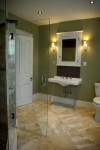 Historic bathroom with antique Kohler sink and honed marble tile floor