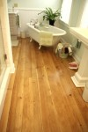 Historic bath renovation with wide plank pine floors