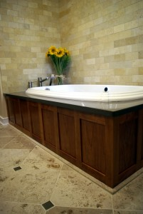 Kohler whirlpool tub with ceasarstone quartz tub deck and limestone tile