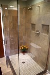 custom tile shower with polished marble and Brizo fixture